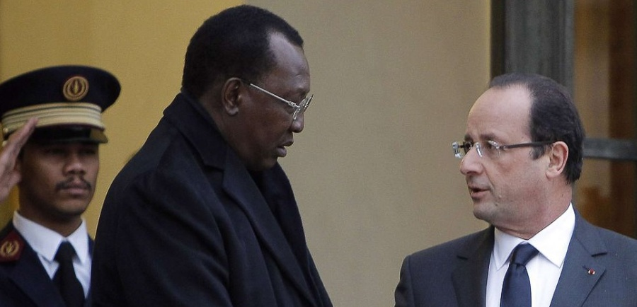 French President Francois Hollande, right, greets Chad President Idriss Deby Itno, left, after their meeting at the Elysee Palace, in Paris, France, Wednesday, Dec. 5, 2012. (AP Photo/Laurent Cipriani)/CIP102/183764739452/1212051644